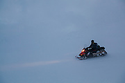 A UNIS student drives a snowmobile on Tellbreen, Svalbard during a class field trip.