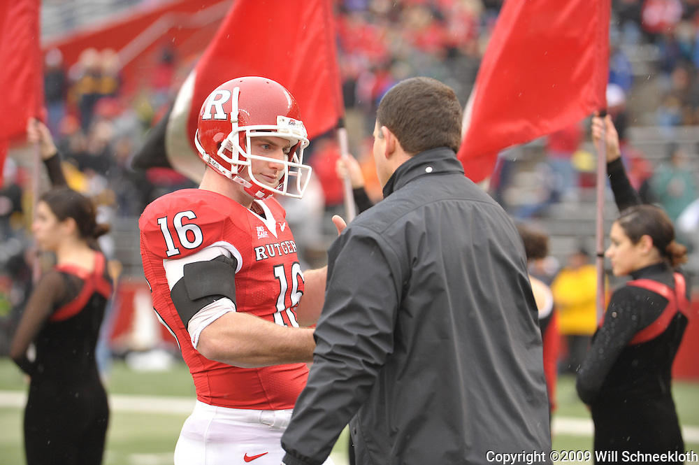Dec 5, 2009; Piscataway, NJ, USA; Rutgers head coach Greg Schiano shakes hands with wide receiver Andrew Depaola during the senior ceremony before first half NCAA Big East college football action between Rutgers and West Virginia at Rutgers Stadium.