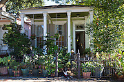 Traditional clapboard cottage house  with columns in the Garden District of New Orleans, Louisiana, USA