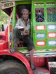 Lorry driver with decorated truck, Mumbai.
