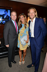 The UK Premier of Johnnie Walker Blue Label's 'Gentleman's Wager' - a short film starring Jude Law was held at The Bulgari Hotel & Residences, 171 Knightsbridge, London on 22nd July 2014.<br /> Picture Shows:-Left to right, LORD HARRY DALMENY, JAKE & SAMIRA PARKINSON-SMITH.