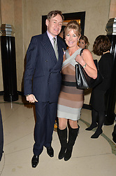 Left to right, NICK FOULKES and EMMA WILLIS at a reception hosted by The Rake Magazine and Claridge's to celebrate London Collections 2015 held at Claridge's, Brook Street, London on 8th January 2015.