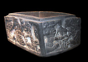 Stone vessel - classic Veracruz, AD300-1200.  The scenes carved on the four sides of this vessel depict two protagonists engaged in a formal contest over a severed trophy head with a tassled plume of long hair.