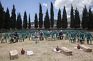 Mourners sit at the Soma cemetery on the outskirts of the mining town. An electrical fault caused an explosion in the shaft resulting in at least 282 workers being killed in the disaster. Soma, Western Turkey.