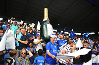 Football - 2015 / 2016 Premier League - Leicester City vs. Everton<br /> <br /> Leicester City fans with an inflatable Champagne bottle at the King Power Stadium.<br /> <br /> COLORSPORT/ANDREW COWIE