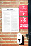 Ground shot of Covid 19 precaution signage and sanitisers that have been put up around he ground ahead of them starting to let supporters back in in a few weeks time, during the EFL Sky Bet League 2 match between Stevenage and Bradford City at the Lamex Stadium, Stevenage, England on 5 April 2021.