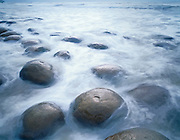 Sandstone concretion formations and surf at Bowling Ball Beach, Mendocino State Park, California