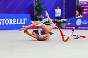 Ashram Linoy during final at ribbon in Pesaro World Cup at Adriatic Arena on April 15, 2018. Linoy  is an Isrlaelian rhythmic gymnastics athlete born on May 13,1999 in Tel Aviv. Her targhet is to win Israel's first Olympic rhythmic gymnastics medal at the 2020 Olympic Games in Tokyo.