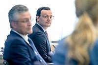 12 FEB 2021, BERLIN/GERMANY:<br /> Prof. Dr. Lothar H. Wieler (L), Präsident Robert Koch-Institut (RKI), Jens Spahn (R), CDU, Bundesgesundheitsminister, Pressekonferenz zur Corona-Lage im Lockdown, Bundespressekonferenz<br /> IMAGE: 20210212-01-026<br /> KEYWORDS: Corvid-19