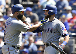 July 16, 2017 - Kansas City, MO, USA - Texas Rangers' Mike Napoli and Jonathan Lucroy pull on each others beards after Napoli's solo home run in the seventh inning during Sunday's baseball game against the Kansas City Royals at Kauffman Stadium in Kansas City, Mo. (Credit Image: © John Sleezer/TNS via ZUMA Wire)