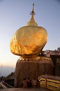 Myanmar, Mon State, Kyaiktiyo Pagoda (Golden Rock Pagoda) A balanced rock covered in gold leaf, major Buddhist stupa and pilgrim site,