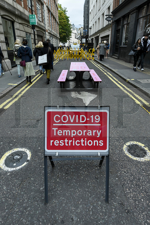 © Licensed to London News Pictures. 26/09/2020. LONDON, UK. A road sign near Carnaby Street in the West End of the capital.  As the number of coronavirus cases continues to rise heralding a second wave of the pandemic, it is reported that London may soon face more comprehensive lockdown restrictions.  Photo credit: Stephen Chung/LNP