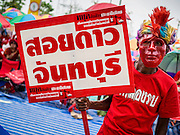 06 APRIL 2014 - BANGKOK, THAILAND: A Red Shirt supporter at the rally in the Bangkok suburbs Sunday. Red Shirts and supporters of the government of Yingluck Shinawatra, the Prime Minister of Thailand, gathered in a suburb of Bangkok this weekend to show support for the government. The Thai government is dealing with ongoing protests led by anti-government activists. Legal challenges filed by critics of the government could bring the government down as soon as the end of April. The Red Shirt rally this weekend was to show support for the government, which public opinion polls show still has the support of most of the electorate.   PHOTO BY JACK KURTZ