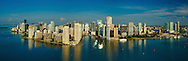 This version is watermarked, contact us for a license and clean version. Aerial panorama of downtown Miami from the east over Biscayne Bay, featuring Bayfront Park, Bayside, the entrance to the Miami River, Brickell and Brickell Key.