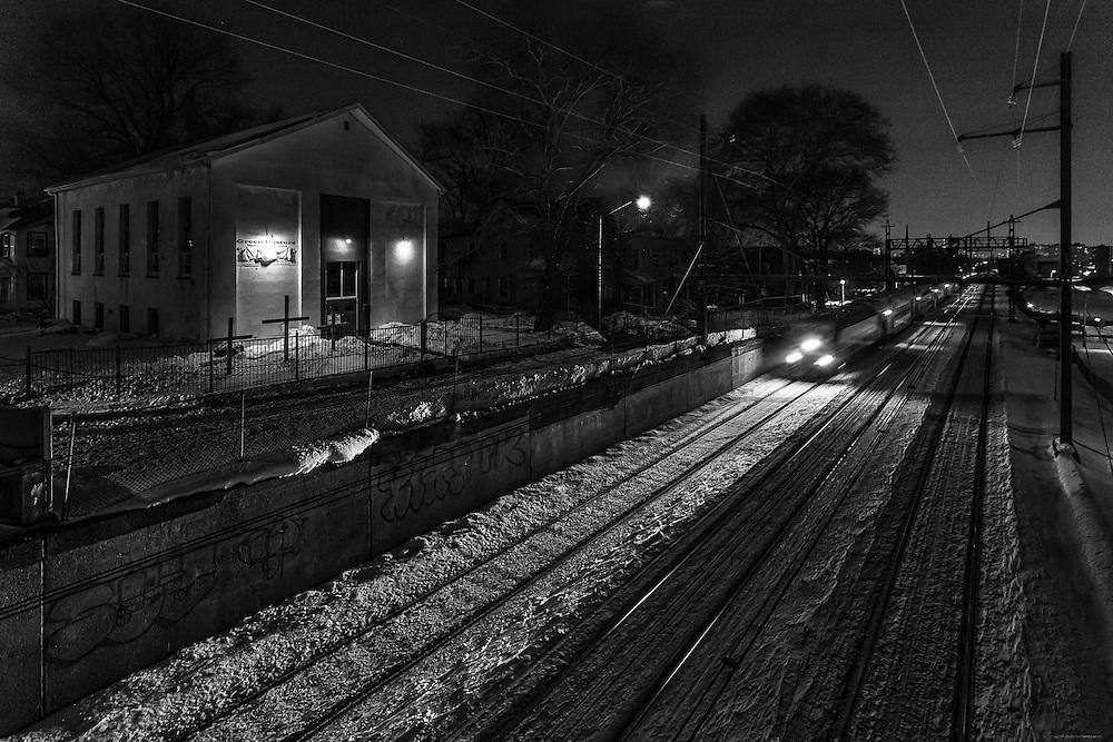 A suburban bound commuter train passes through Newark on a quiet winter night.