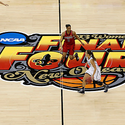 Apr 9, 2013; New Orleans, LA, USA; Connecticut Huskies guard Caroline Doty (5) dribbles against Louisville Cardinals center Sheronne Vails (3) during the first half of the championship game in the 2013 NCAA womens Final Four at the New Orleans Arena. Mandatory Credit: Derick E. Hingle-USA TODAY Sports