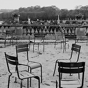 Individuals read amongst scattered chairs in the Jardin du Luxembourg on October 14, 2007 in Paris, France, October 14, 2007. October 22, 2007. Photo Tim Clayton..Paris is often known as 'The City of Love' but like any major City in the world, the inhabitants often live a singular existence, going about their daily lives in relative solitude. Parisians are respectful of each others space, often courteous and polite while extremely conscious of their own image. While love can be seen openly around the streets of Paris, so can the separate lives of Parisians.