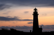 Clouds moving in wind at sunset behind the Yaquina Head Lighthouse 1872, near Newport, tallest on the Oregon Coast