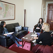 Representative Pramila Jayapal (D-WA, 7), left, and Danielle Fulfs, her Legislative Assistant, second from left, take their first constituent meeting of the day, speaking to Mary Fertakis and -- of the Washington State School Directors Association, on Tuesday, January 31, 2017.  Among other topics of concern, they discussed the potential ramifications of President Trump's immigration and border security policies.  John Boal photo/for The Stranger