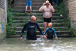 © Licensed to London News Pictures. 31/08/2018. London, UK.  Participants, including Wilf Pryor, aged 8 (right) prepare to take part in the Tidal River Swim in Hammersmith this evening, launching this years Thames Festival. Over 100 brave enthusiasts took part in a 30 minute swim, as they followed the tide towards Chiswich Eycot and back. Photo credit: Vickie Flores/LNP
