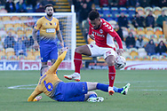 Neal Bishop of Mansfield Town (6) challenges Nicky Ajose of Charlton Athletic (25) during the The FA Cup match between Mansfield Town and Charlton Athletic at the One Call Stadium, Mansfield, England on 11 November 2018.
