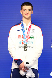 Great Britain's Tim Duckworth celebrates with his silver medal at the Men's Heptathlon during day three of the European Indoor Athletics Championships at the Emirates Arena, Glasgow.