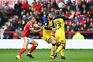 Nottingham Forest forward Jason Cummings (35) battles with in the area with Burton Albion defender John Brayford (2)  and Burton Albion defender Jake Buxton (23) during the EFL Sky Bet Championship match between Nottingham Forest and Burton Albion at the City Ground, Nottingham, England on 21 October 2017. Photo by Jon Hobley.
