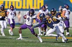 Nov 14, 2020; Morgantown, West Virginia, USA; TCU Horned Frogs wide receiver Taye Barber (4) makes a catch and runs for extra yards during the first quarter against the West Virginia Mountaineers at Mountaineer Field at Milan Puskar Stadium. Mandatory Credit: Ben Queen-USA TODAY Sports