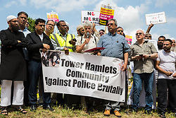 London, UK. 12 July, 2019. A speaker from Stand Up To Racism addresses members of the local community protesting in Poplar after Friday prayers close to the site where Younis Bentahar, aged 38, was violently arrested by Metropolitan Police officers on 10th July following a 5-stage warning. The incident, during which Mr Bentahar appeared to be having a seizure, has since been referred to the Metropolitan Police's Central East Command Professional Standards Unit after a video of the arrest went viral on social media. Mr Bentahar was filmed being struck with handcuffs and pinned down by police officers after he had stopped on a single yellow line with a disabled badge displayed and ignored the five-stage warning.