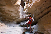 A hiker in slot canyon in Anza-Borrego Desert State Park, California.  (model released)