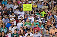 Aug. 21. 2015 Mobile, AL, Trump supporters with  a signs held up while Republican presidential candidate and business mogul Donald Trump speaks at a rally in Ladd Peebles Stadium. <br /> Over 20 thousand came to the Ladd-Peebles Stadium to attend Trumps campaign pep rally. People were asked not to bring signs.