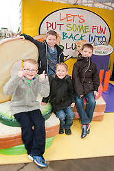 The Kingsmill Big Lunch Tour reaches Sheffield and puts the fun back into lunchtimes as  Harvey Hewat, Josh Brown,  Rylan Fox and Jake Fox sit on a sandwich in the Kingsmill Playzone in Fargate Sheffield on Wednesday...http://www.pauldaviddrabble.co.uk.11 April 2012 .Image © Paul David Drabble