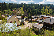 Overview of Barkerville Historic Town & Park, British Columbia, Canada. Historically the main town of the Cariboo Gold Rush, Barkerville is now the largest living-history museum in Western North America. The town was named after Billy Barker from Cambridgeshire, England, who struck gold here in 1861, and his claim became the richest and the most famous. This National Historic Site nestles in the Cariboo Mountains at elevation 1200m (4000ft), at the end of BC Highway 26, 80 kilometres (50 mi) east of Quesnel. Gold here was first discovered at Hills Bar in 1858, followed by other strikes in 1859 and 1860. Wide publication of these discoveries in 1861 began the Cariboo Gold Rush, which reached full swing by 1865 following strikes along Williams Creek.