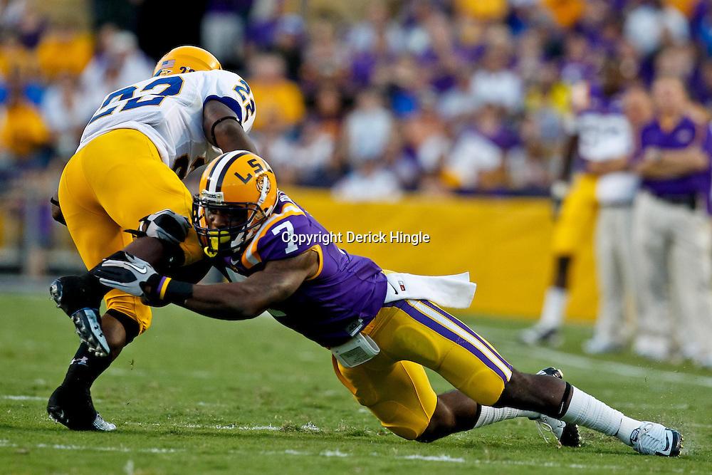 October 16, 2010; Baton Rouge, LA, USA; LSU Tigers cornerback Patrick Peterson (7) tackles McNeese State Cowboys running back Andre Anderson (22) during the first half at Tiger Stadium.  Mandatory Credit: Derick E. Hingle