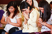 24 OCTOBER 2010 - CHANDLER, AZ: Women pray during the Ok Phansa services to mark the end of Buddhist Lent at Wat Pa, in Chandler, AZ, Sunday October 24. Buddhist Lent is a time devoted to study and meditation. Buddhist monks remain within the temple grounds and do not venture out for a period of three months starting from the first day of the waning moon of the eighth lunar month (in July) to the fifteenth day of the waxing moon of the eleventh lunar month (in October). Ok Phansa Day marks the end of the Buddhist lent and falls on the full moon of the eleventh lunar month, this year Oct 23. Wat Pa, a Thai Theravada Buddhist temple, celebrated Ok Phansa Day on October 24.    Photo by Jack Kurtz
