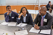 Purchase, NY – 31 October 2014. Yonkers Montessori students Edward Ortiz , left, and Pamela Guerrero with Morgan Stanley facilitator Joshua McCoy. The Business Skills Olympics was founded by the African American Men of Westchester, is sponsored and facilitated by Morgan Stanley, and is open to high school teams in Westchester County.