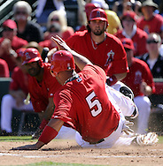 TEMPE, AZ - MARCH 06:  Albert Pujols #5 of the Los Angeles Angels of Anaheim slides home safely against the Chicago White Sox on March 6, 2012, 2012 at Tempe Diablo Stadium in Tempe, Arizona. The Angels defeated the White Sox 6-2.  (Photo by Ron Vesely)  Subject:  Albert Pujols