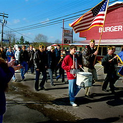 """A veterans day parade in Elizabeth, West Virginia marches past the """"Burger Barn"""" restaurant which is one of two dining options in the small town."""