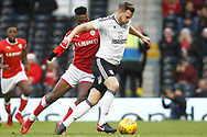 Mamadou Thiam of Barnsley (L) tussles with Tomas Kalas of Fulham (R). EFL Skybet championship match, Fulham v Barnsley at Craven Cottage in London on Saturday 23rd December 2017<br /> pic by Steffan Bowen, Andrew Orchard sports photography.