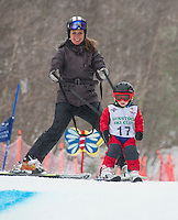 At 3 years old David Stevens shows his mom Tammy Stevens the way through the course during the Meister Cup with the Gunstock Ski Club on Wednesday afternoon.  (Karen Bobotas/for the Laconia Daily Sun)
