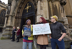 © Licensed to London News Pictures.  03/11/2017; Bristol, UK. Campaigners from the group Countering Colston hold signs outside Bristol Cathedral during the commemoration service of Colston Girls School. The name of Edward Colston is a controversial issue in Bristol. Colston is associated with the slave trade but he also gave away a lot of his wealth to the city and the money helped found various organisations and several schools bear the name Colston. One of Bristol's main music venues, the Colston Hall, will change its name following a refurbishment. Colston Girls School have decided not to change the name of the school but have removed all references to Colston from the commemoration service. Picture credit : Simon Chapman/LNP
