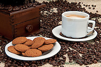 Ginger cookies with espresso coffee and an old coffee grinder.