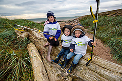 Niamh Duncan (10), Conor Jenkins (3) and Jack Deddie (3) help out. SSE Renewables doing the beach clean in Carnoustie on Saturday morning.