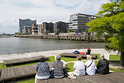 Senior women sitting at Marco-Polo-Terrassen part of modern Hafencity property development in Hamburg Germany