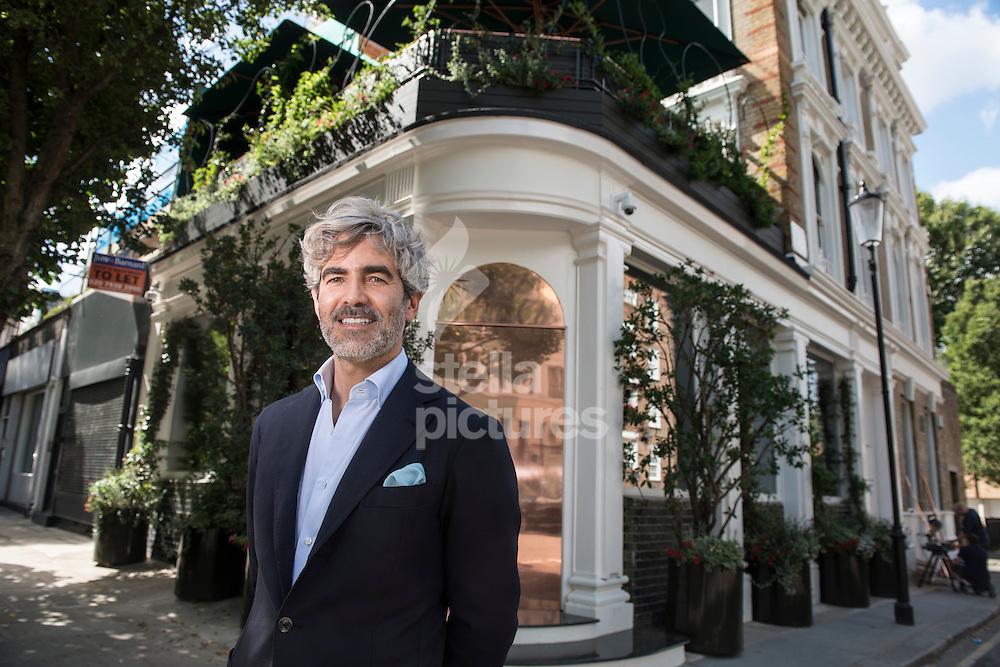 Juan Cruz, owner of Casa Cruz outside his west London restaurant. <br /> Picture by Daniel Hambury/Stella Pictures Ltd +44 7813 022858<br /> 04/08/2015