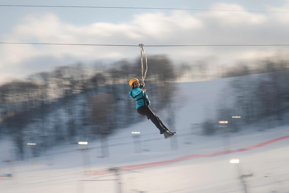Winter ziplining at Boyne Highlands Resort near Petoskey, Michigan.