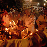 Devotees flow out of the aarti celebration - and make donations -  at Parmarth Niketan Ashram, Rishikesh, India.