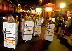 31 October, 2005. New Orleans, Louisiana. <br /> Halloween, post Katrina, New Orleans. As the city returns to a strange sense of normalcy and the citizens return, New Orleans once again hosts a Halloween parade and party. The parade makes its way down Bourbon Street with participants dressed as refrigerators.  <br /> Photo; ©Charlie Varley/varleypix.com