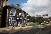 Richmond is a market town and the centre of the district of Richmondshire. Historically in the North Riding of Yorkshire, it is situated on the edge of the Yorkshire Dales National Park. North Yorkshire, England, UK. Local shops and streets off Trinity Church Square.