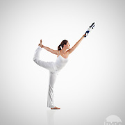 A flexible model photographed for an advertising campaign demonstrating how simple it is to stretch whilst using the Samsung product.